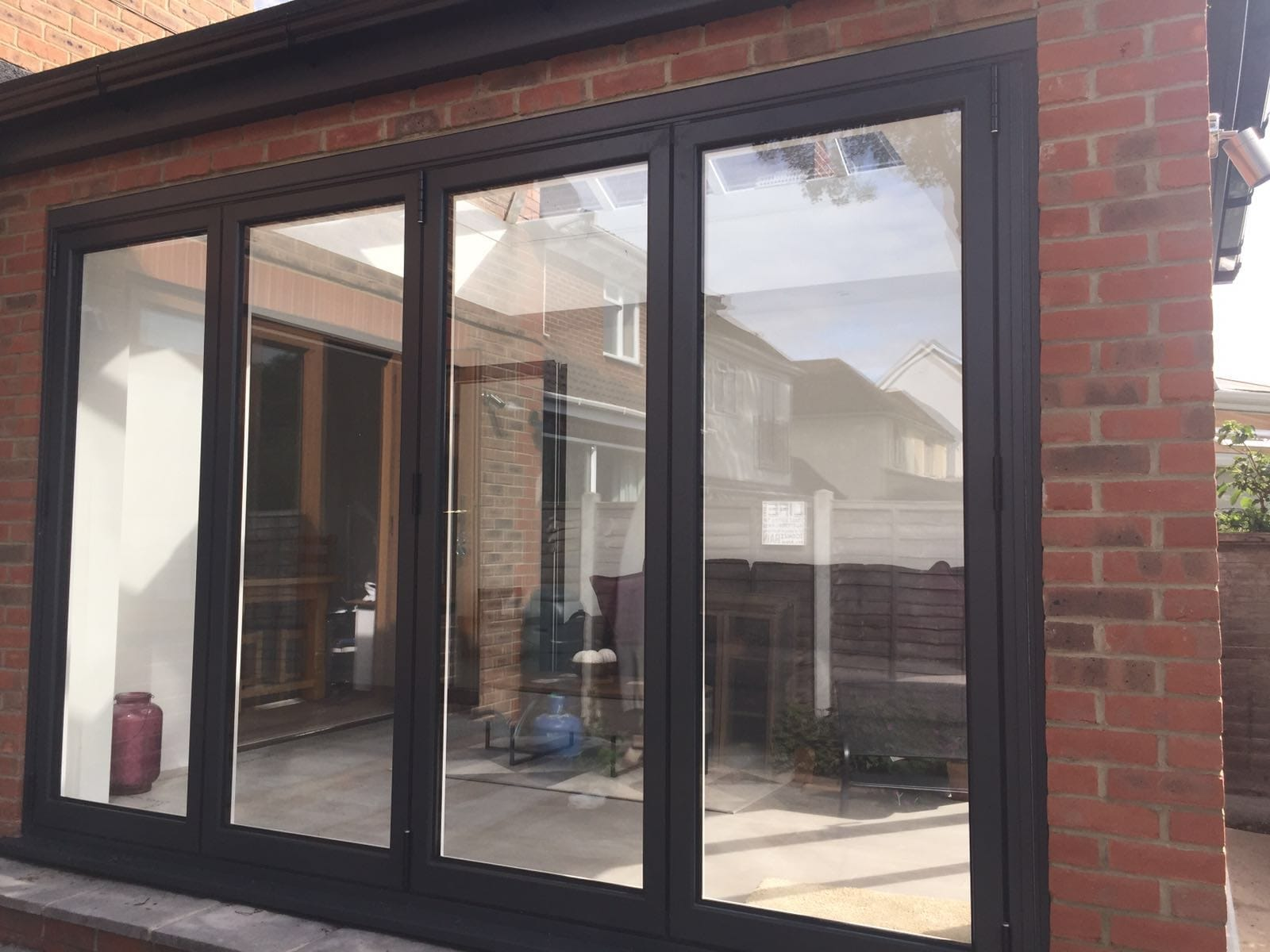 The beauty and benefits of bifold conservatory doors for Conservatory sliding doors